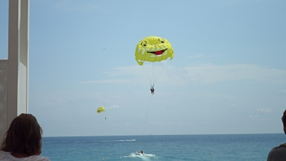 People enjoying a bit of parasailing